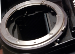 The Nikon F Mount - the stop down lever is closing the diaphragm when a picture is taken