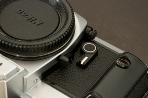 Nikon FA (the round knob controlling the exposure mode ( matrix or center weighted) is on the right side of the lens mount, at the top on this picture
