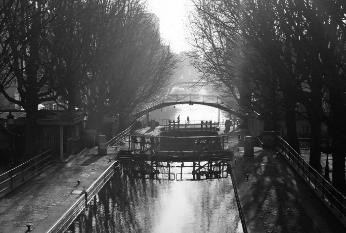 Canal St Martin - Paris - Located between the Gare de l'Est and the Bastille, the canal was a favorite set of the French film makers in the thirties. Using a Leica with B&W film seemed appropriate.