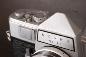 The Sears label on the pentaprism housing. The Sears retained the accessory holder of the Nikkorex.