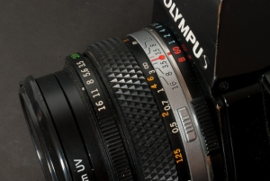 The shutter speed command ring is positioned around the lens mount