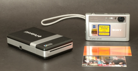 Polaroid PoGo printer next to a Pictbridge compatible camera