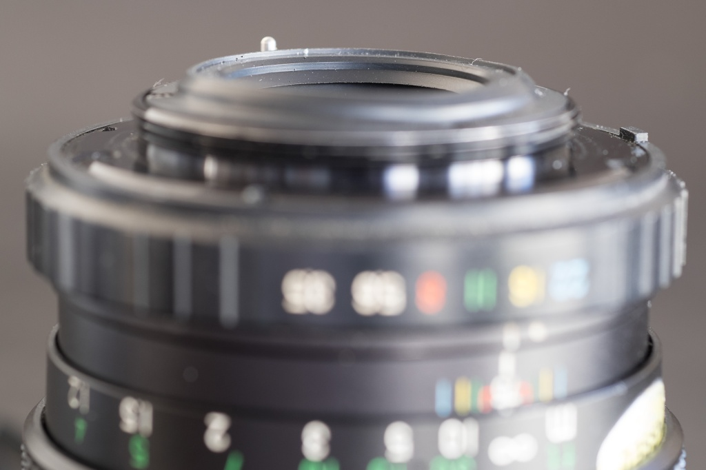 Fujinon lens - the aperture ring is designed with a small tab which transmits the aperture pre-selected by the photographer to a rotating ring on the camera's body.