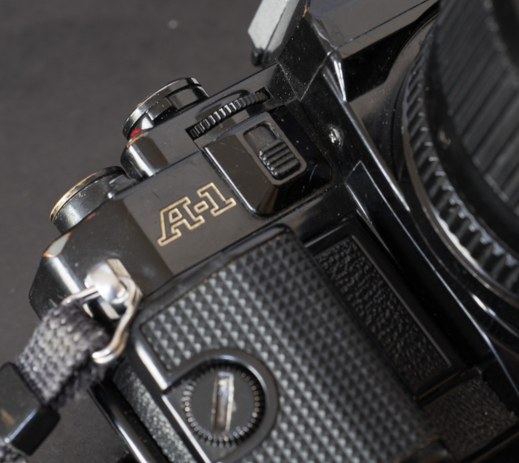 Canon A-1 - the control wheel (on the top late) and the control wheel lock on the front of the body