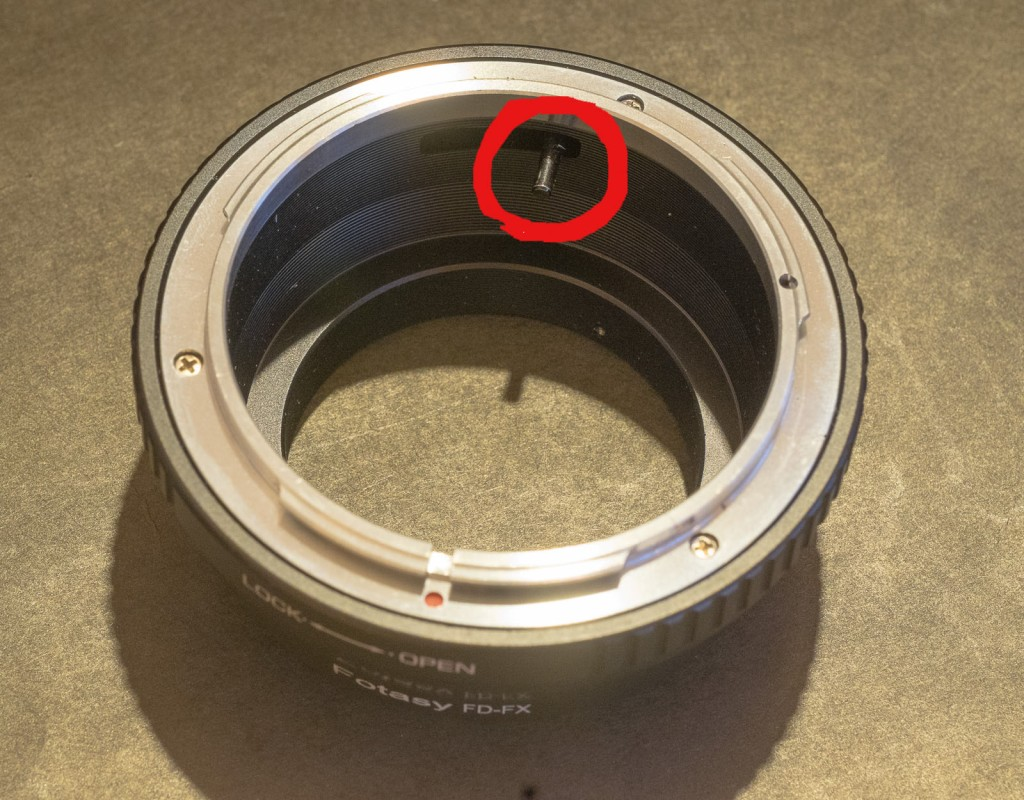 Lens mount adapter for Canon FL/FD lens - the pin in the red circle pushes a lever on the lens and will force it to stop down.