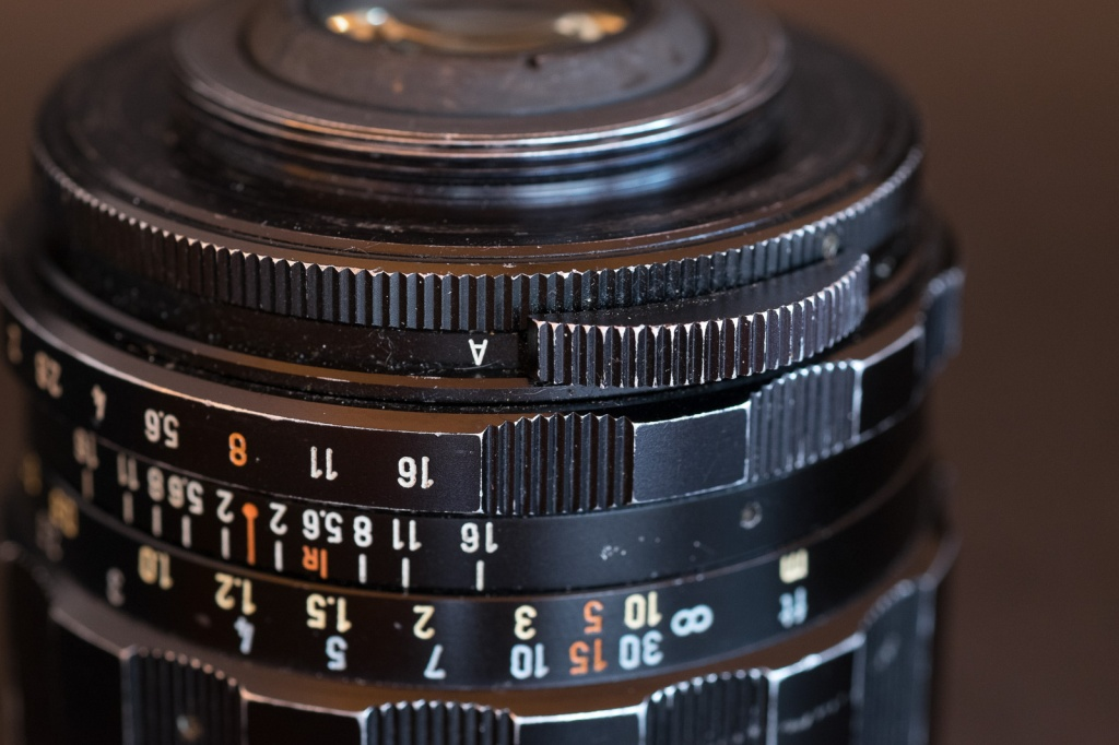 Lenses of the 1965-1975 era often had an auto/manual switch - by default the operated at full aperture but could revert to manual if mounted on an older reflex camera.