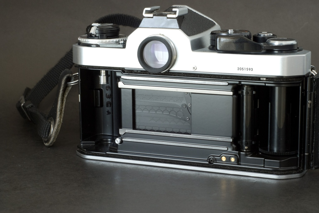 Nikon FE2 - the titanium honeycomb shutter blades of the early copies (like this one) was replaced later on with aluminum ones (for environmental concerns)