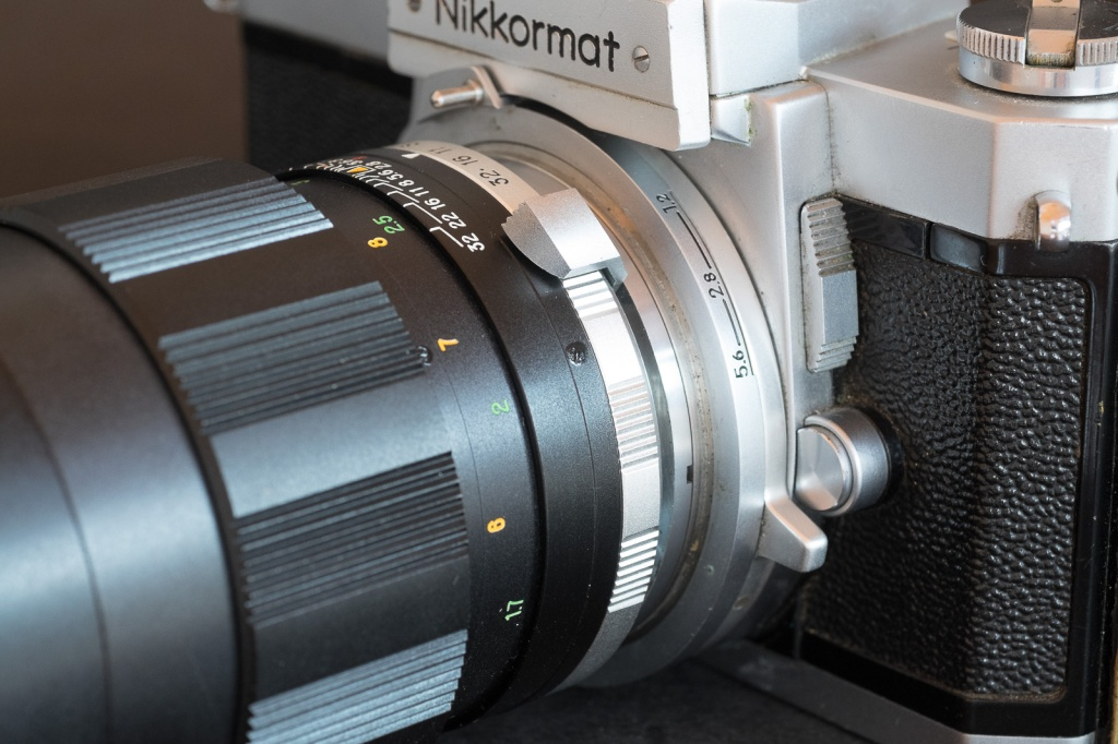 This big lever on this Nikkorex lens has to be pushed down to re-arm the pre-selection system after each shot