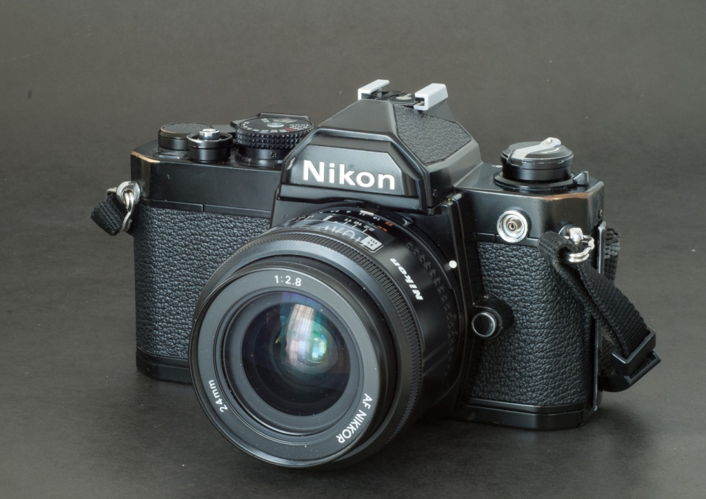 Nikon FM. Brassing on the edges of the top plate cover - no plastic here.