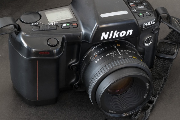 A single control wheel, and the aperture value controlled by the aperture ring on the lens itself: the two major differences between the N90 and a modern Nikon body.